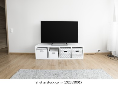 Lcd tv on white shef at modern interior