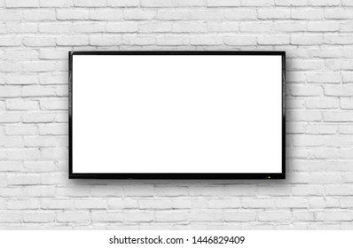 LCD TV with a thin black frame hanging on a white brick wall. Blank white screen. Isolated on white background.