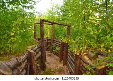 ld wooden trench structure made of ouf wooden elements and protecting soldiers from enemy fire by helping them to duck and start shooting back while in the forest