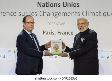 LE BOURGET near PARIS, FRANCE - NOVEMBER 30, 2015 : French President Francois Hollande Receiving book from Prime Minister Narandra Modi during the conference about Solar Alliance at the Paris COP21.