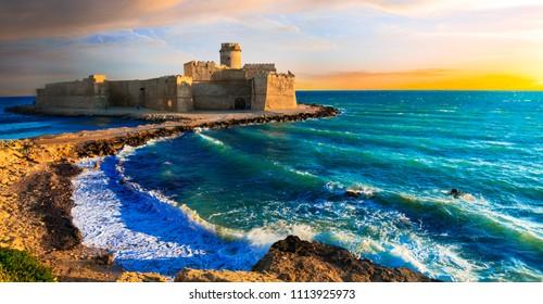 Le Castella .Isola di Capo Rizzuto - Beautiful impressive medeival aragonese castle over sunset. Calabria , Italy