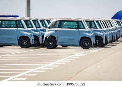 Le Havre, France - June 16, 2021: Brand new Citroën AMI electric license-free microcars are lined up outdoors in the parking lot of the roll-on roll-off (ro-ro) terminal of Le Havre port.