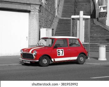 Le Havre, France - May 3 2009:  Mini Cooper Black and White Photography. Red Retro Car Austin Mini Cooper Parked on the Streets of Le Havre in the Normandy region