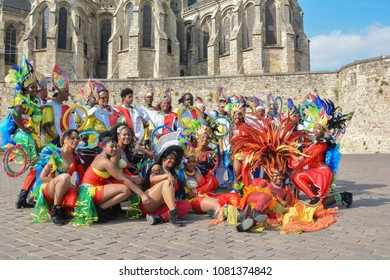 LE MANS, FRANCE - APRIL 22, 2017: Festival Europe jazz People dancing in carribean costumes near Roman cathedral of Saint Julien at a Le mans Sarthe