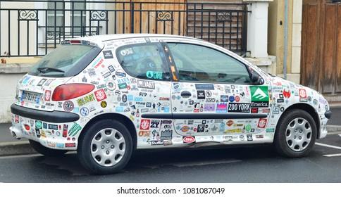 LE MANS, FRANCE - April 25, 2017: car stickers cover a white car Peugeot