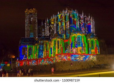 LE MANS, FRANCE - AUGUST 28, 2016: Night of chimera Illuminated perfomance on the wall of Roman and gothic cathedral Saint Julien at Le mans Sarthe, Pays de la Loire
