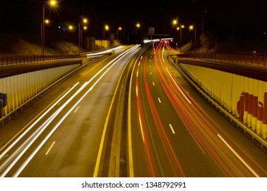 Le Mans FRANCE March 25, 2019: light trail - long exposure of a car passing in under a bridge at night