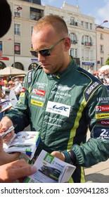 LE MANS, FRANCE-JUNE 11, 2017: Danish race car driver Marco Sorensen Aston Martin Racing gives autograph at a parade of pilots racing