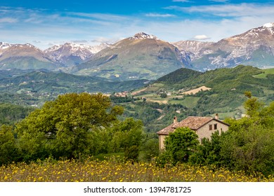 Le Marche Region of Italy, Farmhouse in landscape towards the Sibillini National Park