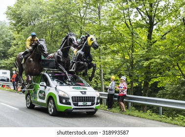LE MARKSTEIN, FRANCE - JUL 13:PMU (Le Pari Mutuel Urbain) vehicle during  the passing of the Publicity Caravan on mountain pass Le Markstein in the stage 9 of Le Tour de France on July 13, 2014