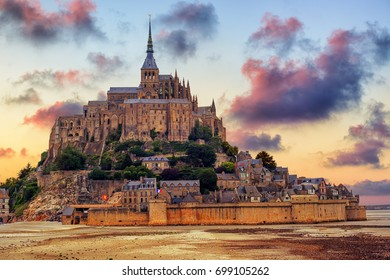 Le Mont Saint Michel island, one of the most visited historical sites in France, on dramatic sunset