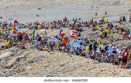 LE MONT VENTOUX, FRANCE-JUL 14:  Crowd of people waiting for the cyclists on the rocky slopes of Mont Ventoux during the stage 15 of the edition 100 of Le Tour de France on July 14 2013.