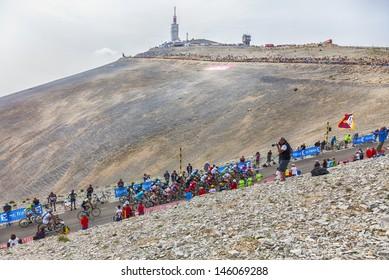LE MONT VENTOUX, FRANCE-JUL 14: A part of the peloton, climbing the last kilometer of the ascension to Mont Ventoux during the stage 15 of the 100 edition of Le Tour de France on July 14 2013.
