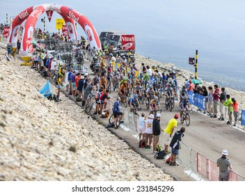 LE MONT VENTOUX, FRANCE-JUL 14: The peloton passing the 1 Km milestone on the road to the top of Mont Ventoux during the stage 15 of Le Tour de France on July 14 2013.