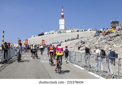 LE MONT VENTOUX, FRANCE-JUL 14:Amateur cyclists climbing the road to Mount Ventoux before the apparition of the competitors during the stage 15 of Le Tour de France on July 14 2013.