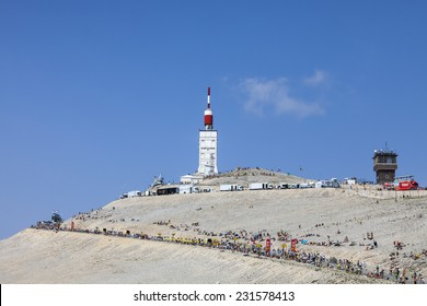 LE MONT VENTOUX, FRANCE-JUL 14:Arid landscape on Mount Ventoux with people doing various activities before the apparition of the competitors during the stage 15 of Le Tour de France on July 14 2013.