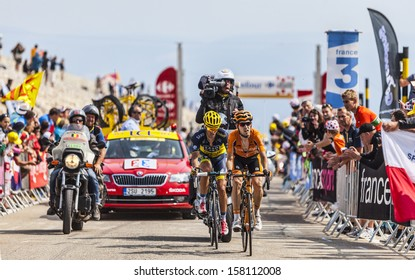 LE MONT VENTOUX, FRANCE-JUL 14:The cyclists Mikel Nieve Iturralde and Alberto Contador,climbing the last kilometer of the ascension to Mont Ventoux in the stage 15 of Le Tour de France on July 14 2013
