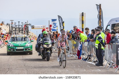 LE MONT VENTOUX, FRANCE-JUL 14:The cyclist Pierre Rolland wearing the Polka Dot Jersey,climbing the last kilometer of the ascension to Mont Ventoux in the stage 15 of Le Tour de France on July 14 2013
