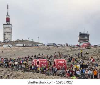 LE MONT VENTOUX, FRANCE-JUL 14:Vehicles advertising Vittel on the road to Mont Ventoux summit, while the publicity caravan pass before the peloton in the stage 15 of Tour of France on July 14 2013