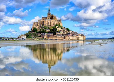Le Mont-Saint-Michel island with historical monastery reflecting in tidal water, Normandy, France