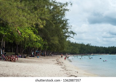 Le Morne beach / Mauritius - 08.01.2019: Local people enjoy the beautiful beach along with the tourists from all over the world.