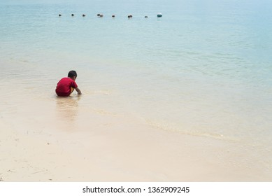 Le Morne beach / Mauritius - 08.01.2019: Local children enjoy the beautiful beach along with tourists from all over the world.