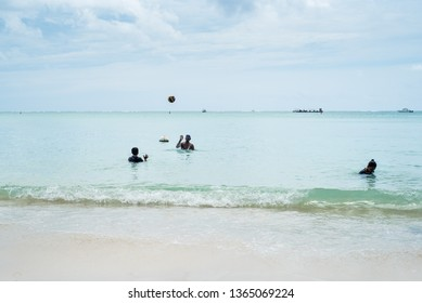 Le Morne beach / Mauritius - 08.01.2019: Local people enjoying the tropical beach along with tourists from all over the world.