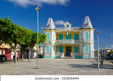 LE MOULE/GUADELOUPE - JANUARY 31, 2018: Town hall in Le Moule in Guadeloupe. Typical colorful colonial house in the main town`s sqare.