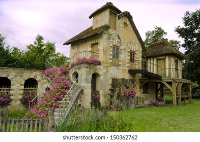 Le Moulin located in the Queen�s hamlet in the Trianon � Versailles, France - Shutterstock ID 150362762