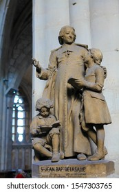 Le Treport, France - October 5, 2019: Statue in the Church of St James in Le Treport, France, of St Jean Baptiste de la Salle, saint of the Catholic Church and the patron saint for teachers of youth.