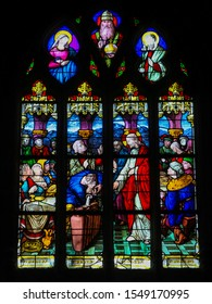 Le Treport, France - October 5, 2019: Stained Glass in the Church of St James in Le Treport, France, depicting Jesus and Mary at the Marriage at Cana