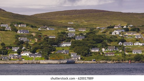LEABGARROW, ARAN ISLAND, DONEGAL, IRELAND - AUGUST 17, 2006: Homes and buildings, settlement on hill near Leabgarrow, Arranmore Island, also known as Aran Island.