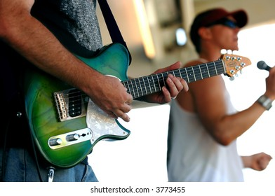Lead Guitar in Foreground; Lead Singer in Background
