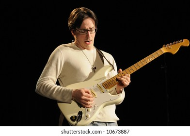 """Lead guitarist in the band """"Amalgamation"""" playing guitar in a live concert"""