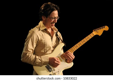 """lead Guitarist of the group """"Amalgamation"""" playing while isolated on black during live concert"""