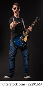 Lead guitarist. Located on the black background.