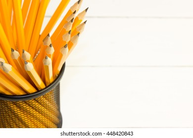 lead pencils in metal cup isolated on white background