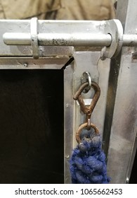 lead rope clipped onto stable door