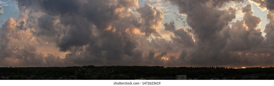 Leaden, storm clouds covered the sunset. Cumuliform cloudscape on blue sky. The terrain in southern Europe. Fantastic skies on the planet earth. Tragic gloomy sky.