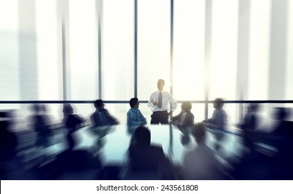 The leader of the business people giving a speech in a conference room.