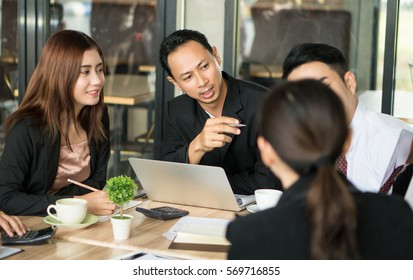 Leader businessman brainstorming working and explain job with partner or co-worker.