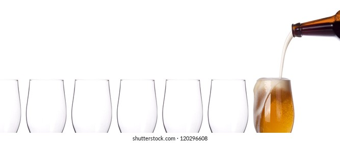 leader concept - empty and one full beer glass isolated on a white background