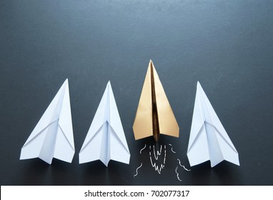 Leader concept, gold paper plane