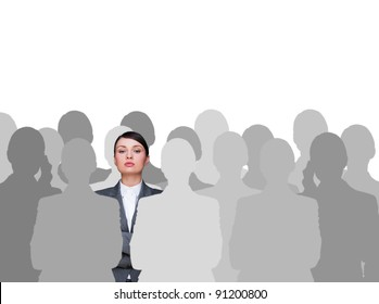 Leader concept. Portrait of young business woman standing with hands folded and grey people silhouettes are standing around her