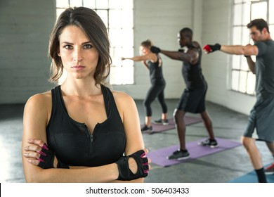 Leader of fitness group coed unisex class strong powerful expression small business owner