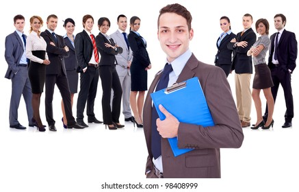 Leader holding a clipboard with business team behind, isolated on white. young business man holding a clipboard in front of a large happy business team