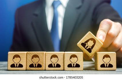 The leader integrates the female employee into the male staff team. Gender imbalance, creation gender balance in the company to improve work efficiency. Gender equality. Unified career potential.