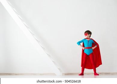 Leader. Kid superhero in a red cloak.