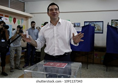Leader of left-wing Syriza party and former Prime Minister Alexis Tsipras casts his vote at a polling station in Athens, Sunday, Sept. 20, 2015.