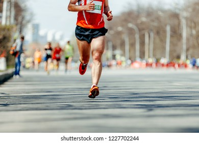 leader man runner marathon race on spring city street